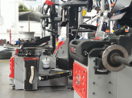 Installed PTC520 tyre changer ready for efficient testing alongside the PWB90.